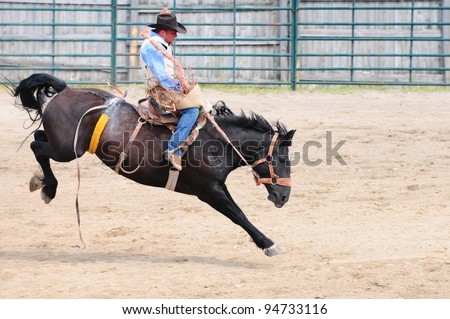 BOULDER - AUGUST 27th: unidentified cowboy rides in the saddle bronc competition at Jefferson County Fair and Rodeo on august 27, 2011 in Boulder, Montana - stock photo