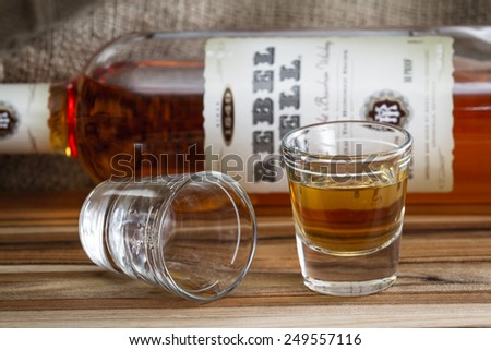 Boulder City Nevada - December 25 : Shot glasses with a bottle of Rebel Yell bourbon in the background, December 25 2014 in Boulder City, Nevada - stock photo