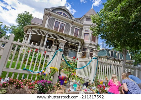 "BOULDER, CO - AUG. 16: Fans pay tribute to the late Robin Williams outside the home featured in the popular TV series ""Mork & Mindy"" on August 16, 2014."