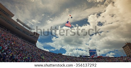 BOULDER, CO - May 25th, 2015 - US Military service men stand in formation for the national anthem during the Bolder Boulder 10K Memorial Day service at Colorado University's Folsom Field - stock photo