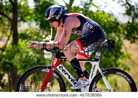 Boulder, Colorado, USA - August 7, 2016: Mark Chamberlain on the bike at Ironman Boulder.
