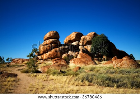 boulder formations at the Devils Marbles Conservation Reserve - stock photo