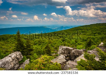 Boulders and eastern view of the Appalachian Mountains from Bear Rocks Preserve, Monongahela National Forest, West Virginia. - stock photo