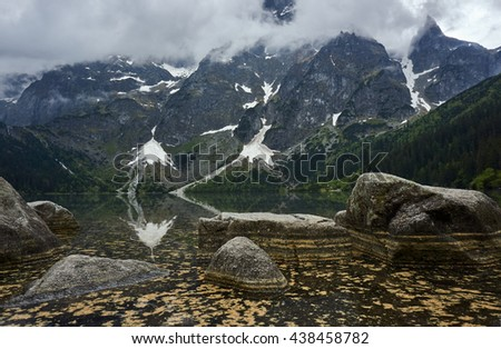 Boulders on the shore of Lake Morskie Oko in the Tatra Mountains in Poland - stock photo