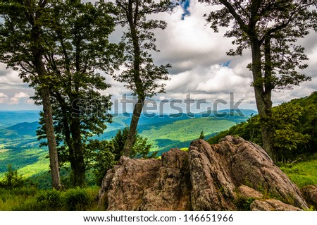 Boulders, trees, and view of the Blue Ridge at an overlook on Skyline Drive in Shenandoah National Park, Virginia. - stock photo