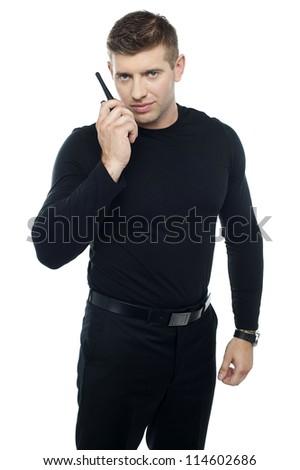 Bouncer guy communicating. Isolated against white background - stock photo