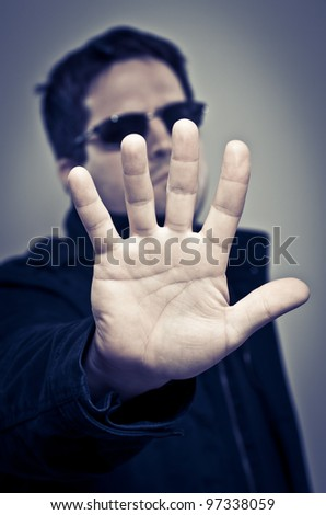 Bouncer rejecting entry - stock photo