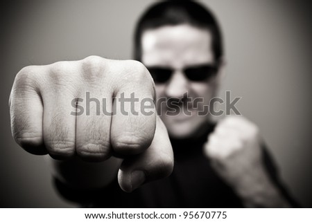 Bouncer throws a punch - stock photo