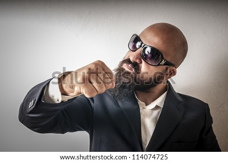 bouncer with jacket and sunglasses on white background