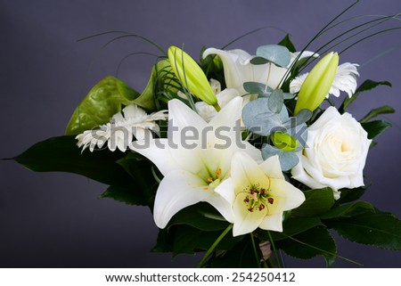 bouquet bunch of beautiful white flowers with white roses, lily and daisy - stock photo