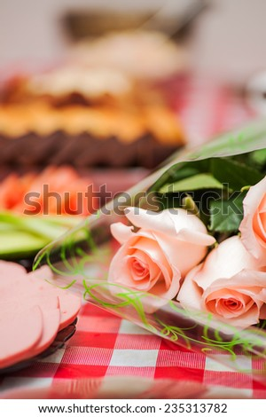 bouquet five pink roses background table - stock photo