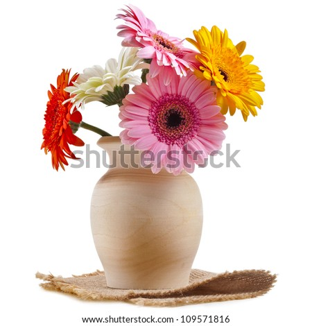 Bouquet flowers gerbera in a wooden vase on a white background - stock photo
