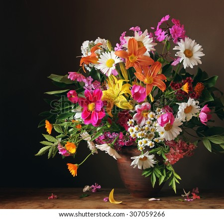 Bouquet from cultivated flowers against a dark background, a still life with a bouquet.