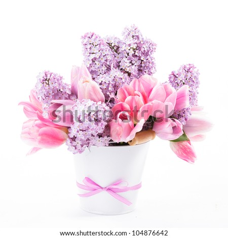 Bouquet from pink tulips and lilac on white - stock photo