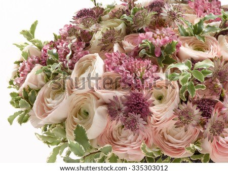 bouquet from ranunculuses, astrantia, scabiosa and pittosporum on white background