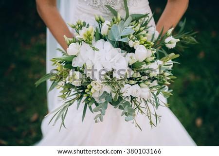Bouquet In Bride`s Hands - stock photo