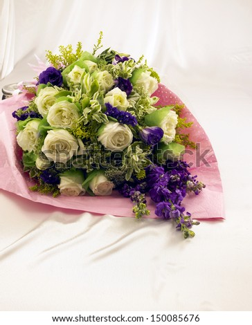 Bouquet in silk cloth background - stock photo