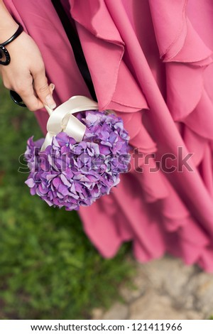 bouquet in the hands of the bridesmaid. Hydrangea flower. - stock photo