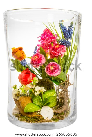 Bouquet of artificial flowers made of plastic in a big glass vase - stock photo