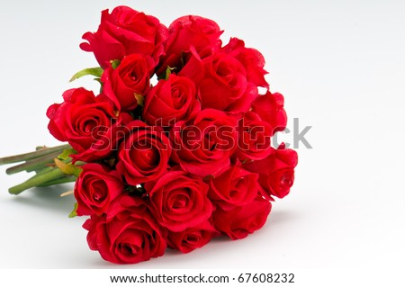 Bouquet of artificial red roses, isolated, space for copy in the side. - stock photo