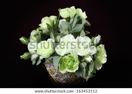 bouquet of artificial roses isolated on a black background