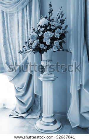 bouquet of beautiful flowers in the vase near the window - stock photo