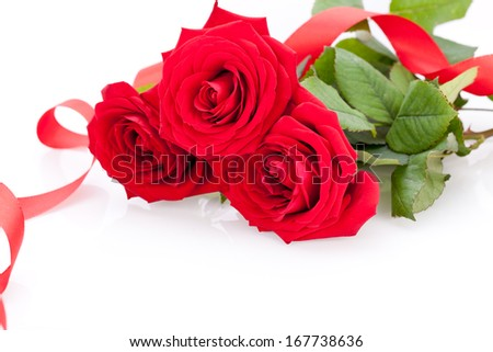 Bouquet of beautiful fresh red roses with a coiled ribbon border isolated on white with plenty of copyspace for your loving anniversary or Valentines message