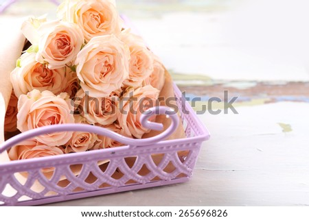 Bouquet of beautiful fresh roses in wicker tray, closeup - stock photo