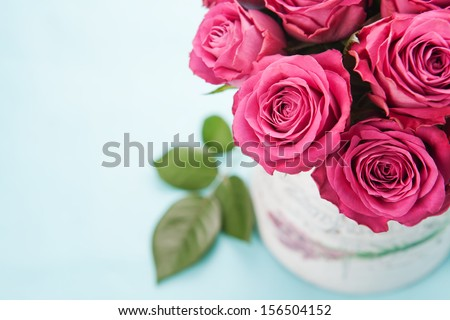 Bouquet of beautiful pink roses on light blue background  - stock photo