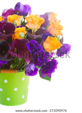 Bouquet of calla lilly, roses and eustoma flowers in green pot  close up isolated on white background - stock photo