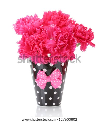 Bouquet of carnations in a cup isolated on white - stock photo