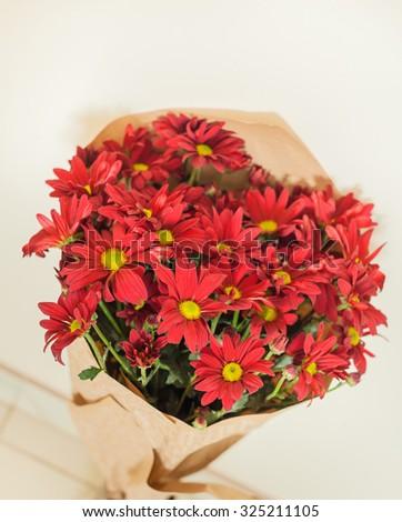 bouquet of chrysanthemum flowers in paper package