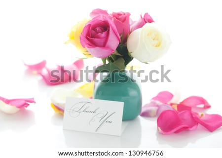 bouquet of colorful roses in vase,petals and card with the words thank you - stock photo