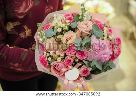 bouquet of eustoma and other pink flowers in hands  - stock photo