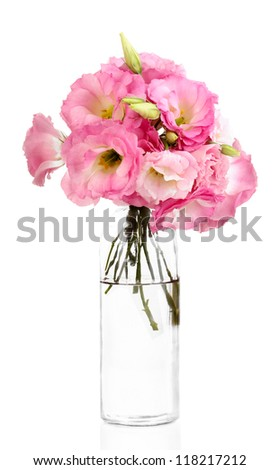 bouquet of eustoma flowers in bottle, isolated on white - stock photo