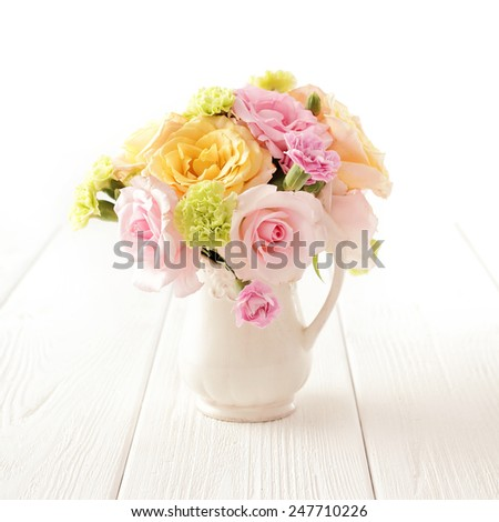 bouquet of flowers in a vase on white background - stock photo