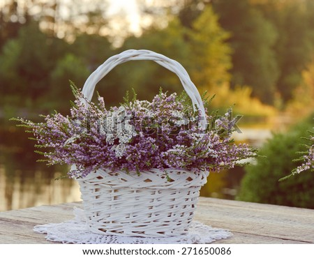 Bouquet of flowers in basket - stock photo