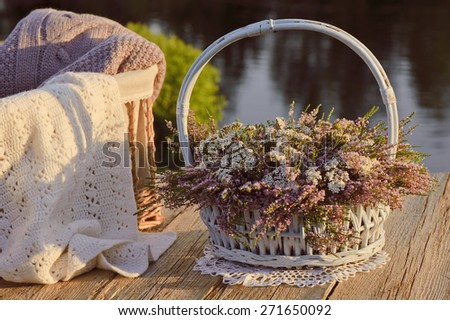 Bouquet of flowers in basket and scarf - stock photo
