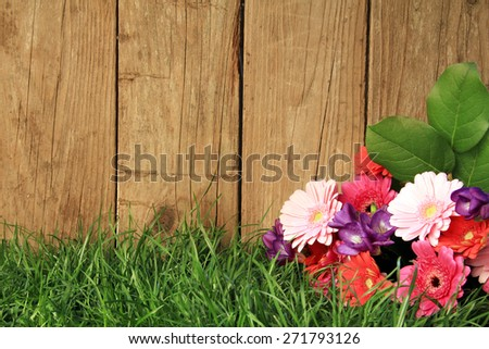 Bouquet of flowers in front of a fence.  - stock photo