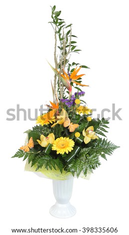 Bouquet of flowers in plastic vase, yellow gerbera daisies and pale yellow orchids, decorated with ferns, isolated on white background. - stock photo