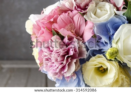 Bouquet of flowers in silver watering can - stock photo