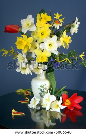 Bouquet of flowers on a table in a living room 3. - stock photo