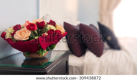 Bouquet of flowers on the hotel nightstand - stock photo