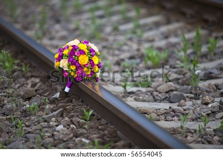 bouquet of flowers sat on the railway