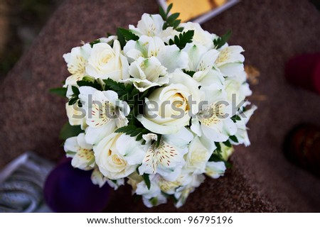 Bouquet of flowers white roses and lily on brown background