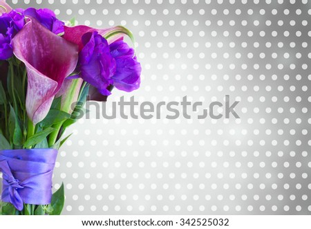 Bouquet of fresh calla lilly and eustoma flowers  on  gray bokeh background - stock photo