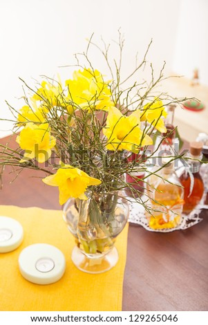 bouquet of  fresh narcissus flowers on a living room table. - stock photo