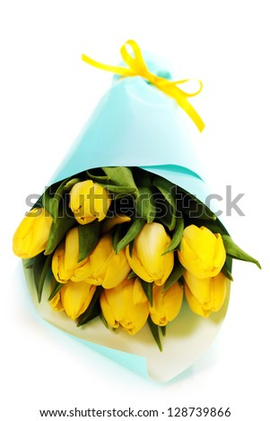 bouquet of  fresh yellow tulips on white background - stock photo