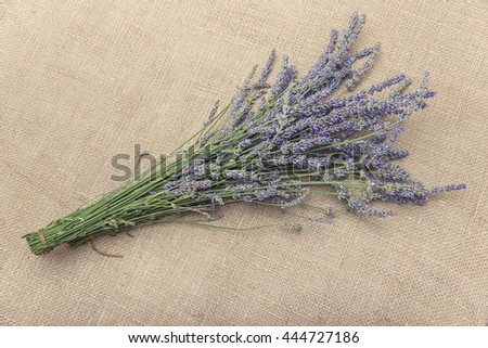 Bouquet of lavender on sacking. Place for placing of your text.