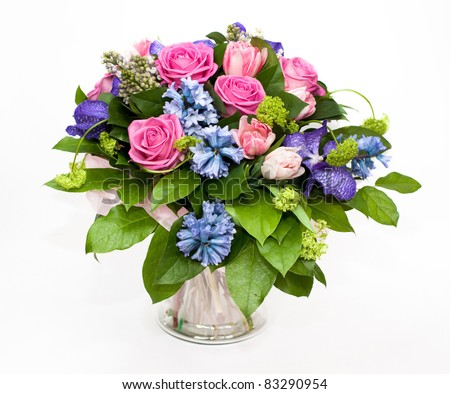 bouquet of lilas and roses in glass vase - stock photo